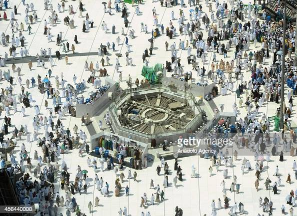 Muslim pilgrims walk around an empty space left from previously dismantled historical colonnade built by Ottoman Empire in the Kaaba the Muslim's...