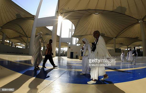 Muslim pilgrims walk outside the King Abdul Aziz airport upon their arrival to the Red Sea port city of Jeddah on November 27 2008 Muslim pilgrims...
