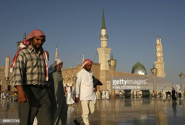 Muslim pilgrims walk outside the Prophet Mohammed Mosque in the Saudi holy city of Medina on December 13 2008 Statistics put the total number of...