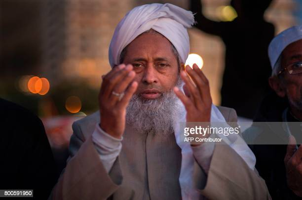A Muslim prays as he attends the evening prayer at Three Anchor Bay in Cape Town on June 24 as Islamic leaders attempt to sight the new moon which...