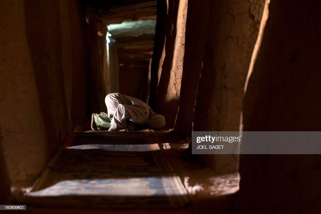 A Muslim prays near the Askia mosque on February 27, 2013 in Gao. Chad's President Idriss Deby Itno on Wednesday urged the Malian army and West African force to speed up the deployment of troops to northern Mali to help fight Al-Qaeda-linked rebels.