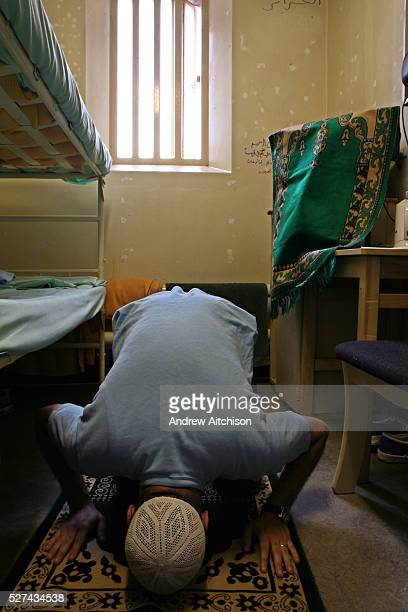A Muslim prisoner prays on his matt inside his cell at Wandsworth prison HMP Wandsworth in South West London was built in 1851 and is one of the...
