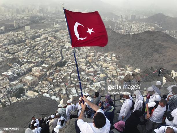 Muslim prospective pilgrim carries Turkish flag as the pilgrims climb the Jabal alNour to visit Hira Cave during the annual Hajj pilgrimage in Mecca...