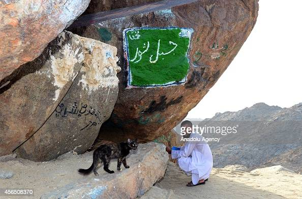 Muslim prospective pilgrim rests at the Jabal Thawr housing a cave known as Ghar alThawr where the Islamic Prophet Muhammad and his companion Abu...