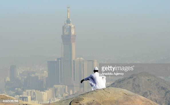 Muslim prospective pilgrim sits at the top of Jabal Thawr housing a cave known as Ghar alThawr where the Islamic Prophet Muhammad and his companion...