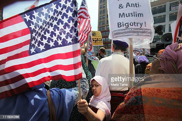 Muslim protester Farzana Sabrina waves an American flag at a large antiwar rally in Union Square on April 9 2011 in New York City Thousands of...