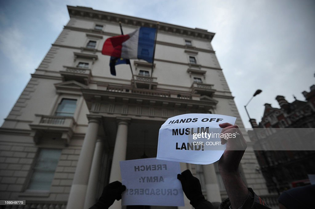 A Muslim protester holds up a sign that reads 'Hands Off Muslim Land' during a demonstration in response to French military action in Mali outside the French embassy in central London on January 12, 2013. Around 50 Muslim protesters shouted slogans and waved signs as they demonstrated outside the French embassy against French intervention in Mali. France sent troops on January 11 to help Malian forces hold back a rebel advance towards the capital Bamako, and on January 12 Paris announced that a French military pilot had been killed.