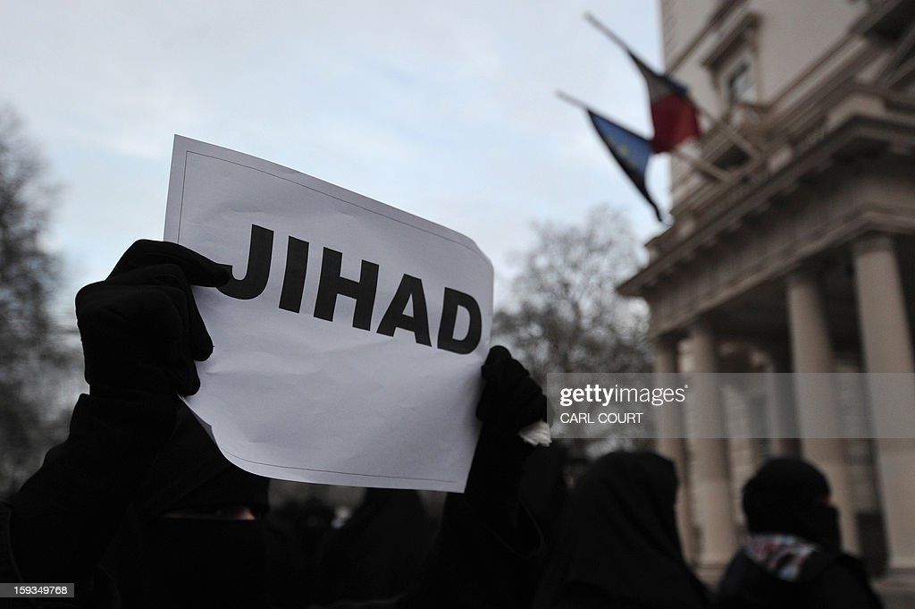 A Muslim protester holds up a sign that reads 'Jihad' during a demonstration in response to French military action in Mali outside the French embassy in central London on January 12, 2013. Around 50 Muslim protesters shouted slogans and waved signs as they demonstrated outside the French embassy against French intervention in Mali. France sent troops on January 11 to help Malian forces hold back a rebel advance towards the capital Bamako, and on January 12 Paris announced that a French military pilot had been killed.