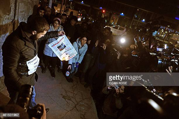 A Muslim protestor facing the media sets alight a copy of Turkish daily Cumhuriyet during a protest against the publication by the daily of a a four...