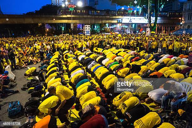 Muslim protestors kneel and pray as they attend Maghhrib the evening prayer near the Merdeka Square during the Coalition for Clean and Fair Elections...