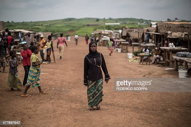 A Muslim refugee form Central African Republic walks along a street at the Mole refugee camp 35 Kms south of Zongo at the Equator region on June 20...