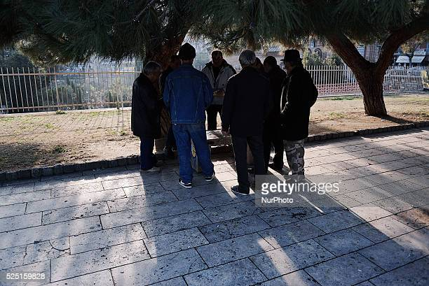 Muslim refugees playing cards at an area near the guesthouse building Due to its geographical position Greece has the role of immigrants reception...