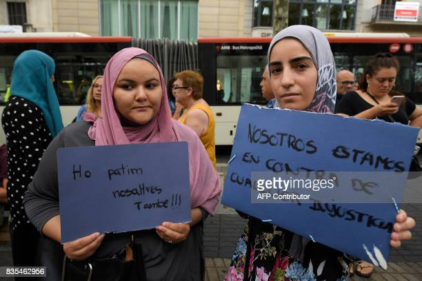 Muslim residents of Barcelona hold placards reading 'We are aginst any injustice' and 'We are also afraid' as they demonstrate on the Las Ramblas...