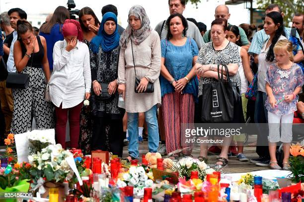 TOPSHOT Muslim residents of Barcelona pay tribute at the Canaletas fountain during a demonstration on the Las Ramblas boulevard in Barcelona to...