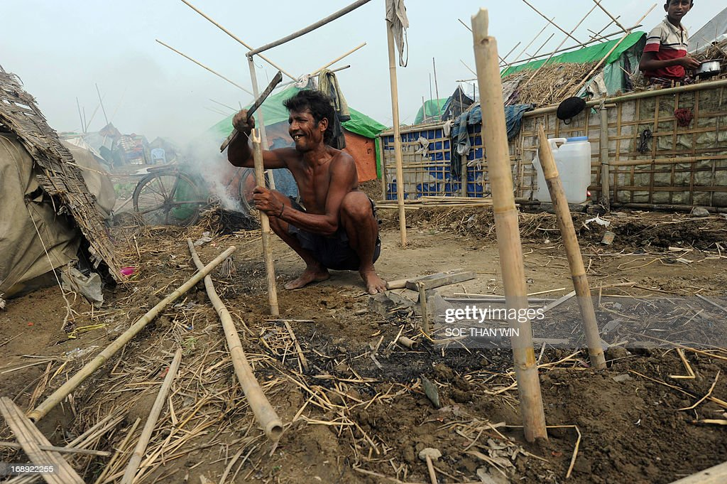 A Muslim Rohingya man works on constructing a tent after arriving back to a camp for iternally displaced people in the village of Mansi on the outskirts of Sittwe on May 17, 2013. Bangladesh and Myanmar cleaned up on May 17 after a killer cyclone wrecked thousands of homes, relieved that the damage was not much worse after the storm weakened as it made landfall. At least 40 people were either killed by Cyclone Mahasen or while trying to flee its impact, including 25 Muslim Rohingya whose bodies washed up on the shores of Bangladesh after their boat capsized while sailing from Myanmar. AFP PHOTO / Soe Than WIN