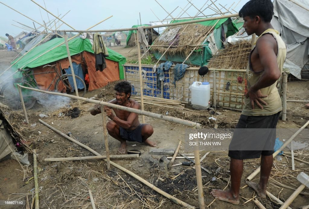 A Muslim Rohingya man works on constructing a tent after arriving back to a camp for internally displaced people in the village of Mansi on the outskirts of Sittwe on May 17, 2013. Bangladesh and Myanmar cleaned up after a killer cyclone wrecked thousands of homes, relieved that the damage was not much worse after the storm weakened as it made landfall. AFP PHOTO / Soe Than WIN