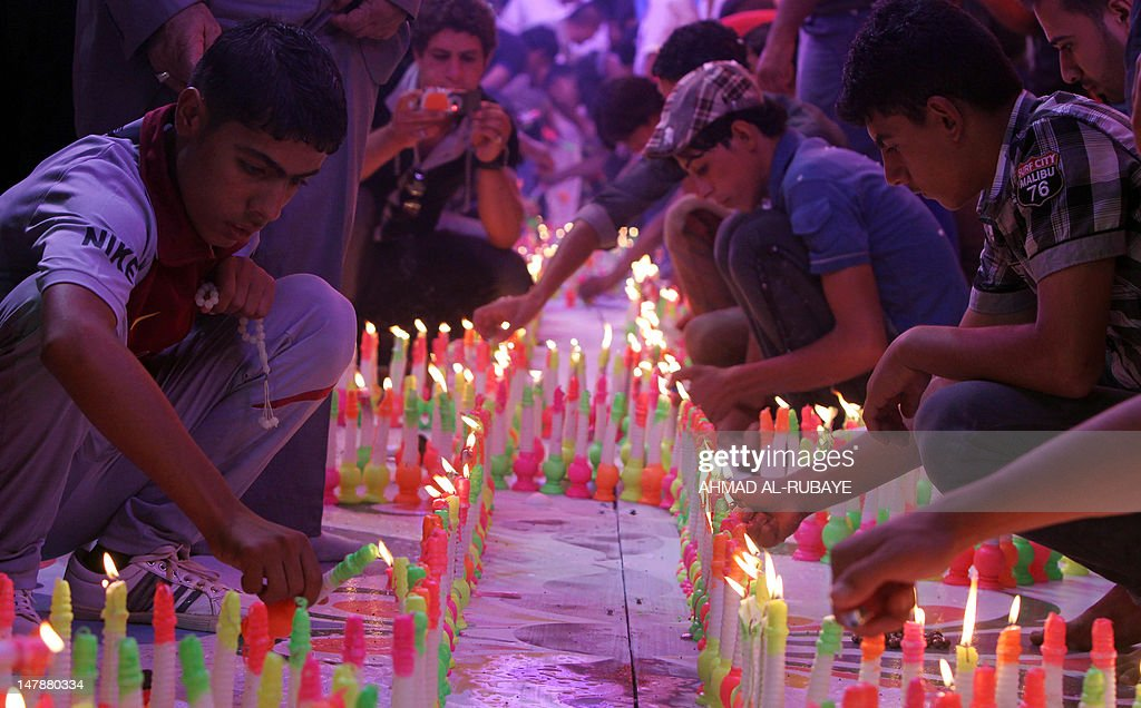 Muslim Shiites light candles during celebrations for the Shaabaniya ceremony which commemorates the birth of Imam al-Mahdi, the 12th holiest figure for Shiite Muslims, in the central Iraqi city of Karbala, on July 5, 2012. Mahdi is the 12th Imam who disappeared in the ninth century and Shiites believe that he will appear before the end of time to establish justice and true Islam in the world.