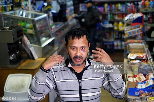 Muslim shopkeeper Sarkar Haq who was beaten in an alleged hate crime speaks during an interview at his shop in New York on December 7 2015 Muslim...
