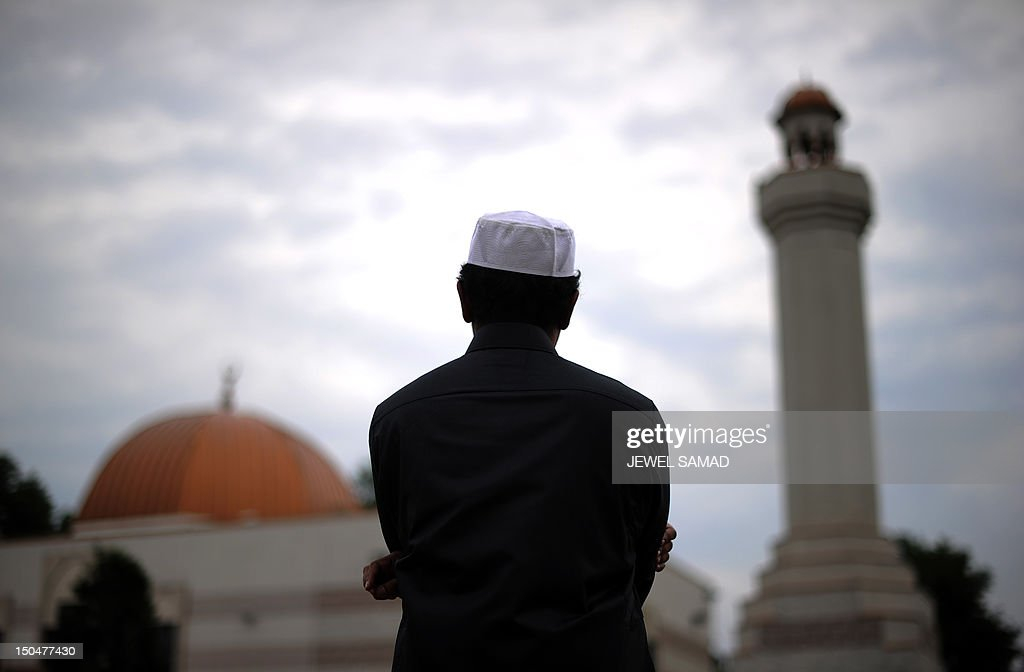 A Muslim takes part in a special morning prayer to start EidalFitr festival marking the end of their holy fasting month of Ramadan at a mosque in...
