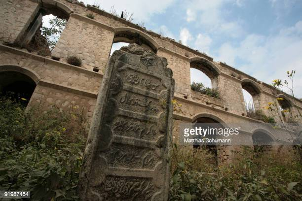 A muslim tombstone on the cemetery of a damaged mosque is seen in Shushi on September 24 2007 in NagornoKarabakh Azerbaijan Shushi is the second...