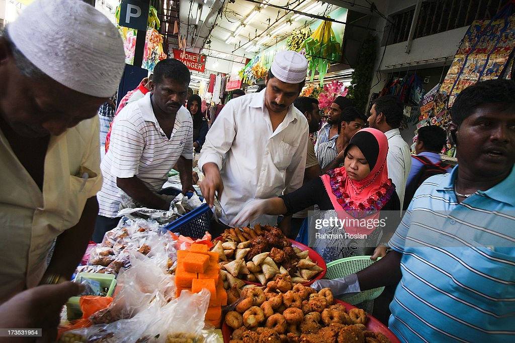 Muslim traders and customers sells and buys food hours before breaking their fast as millions of Muslims observe the holiday of Ramadhan on July 16, 2013 in Jalan Masjid India, Kuala Lumpur, Malaysia. During Ramadhan, Muslims refrain from consuming food, drinking liquids, smoking, swearing, and engaging in sexual relations from dawn till sunset.