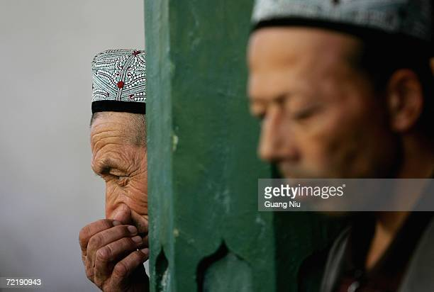 Muslim Uyghurs attend afternoon prayers at the Id Kah Mosque on October 15 2006 in Kashgar City Xinjiang Uygur China The Turkicspeaking Muslim...