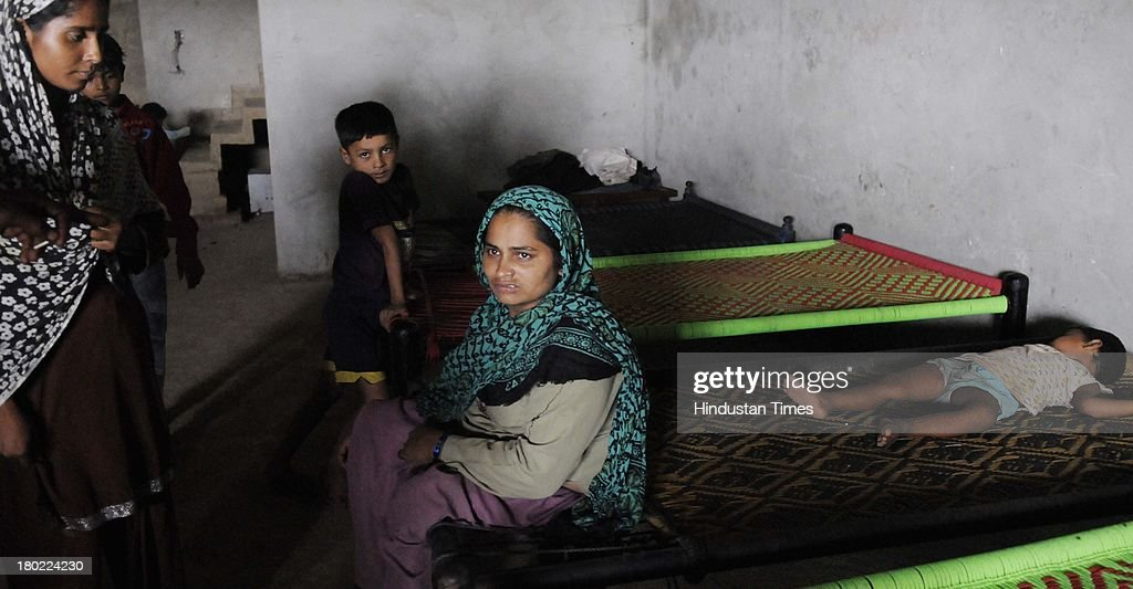 Muslim villagers who have taken shelter at Islam Nagar in Shahpur area during communal violence on September 10, 2013 in Muzaffarnagar, India. No untoward incident was reported from Muzaffarnagar today as 975 people were arrested for their direct or indirect role in the communal violence that has left 35 dead.