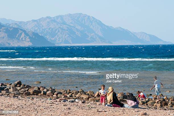 Muslim woman and children (Dahab, Egypt)