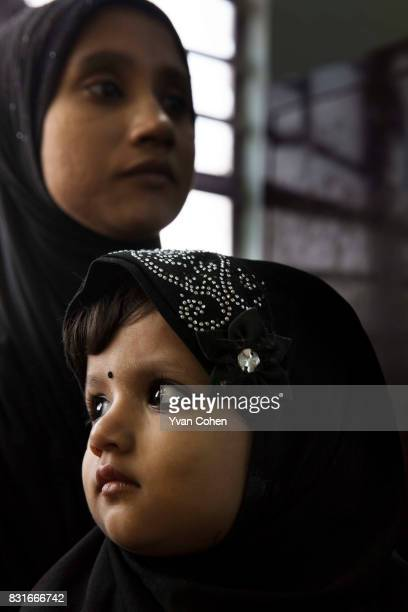Muslim woman and her child wait at a clinic in the Fakir Bagan slum area of Kolkata The clinic is run by the charity Calcutta Kids Founded in 2004...