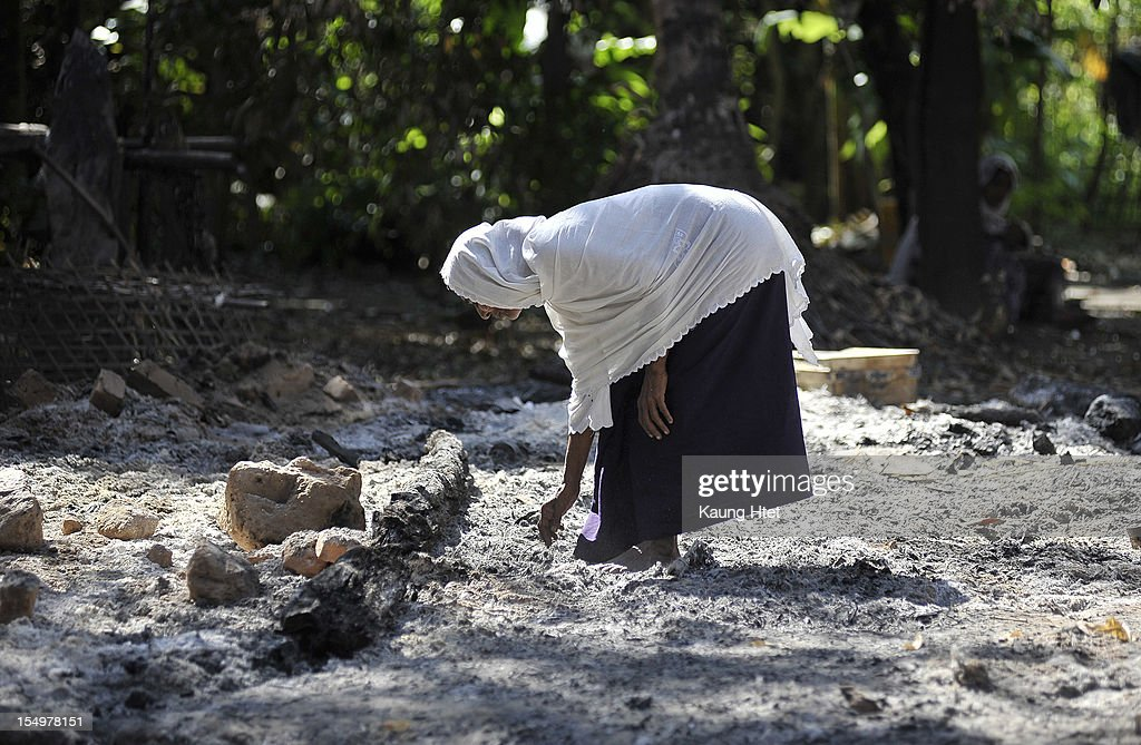 A Muslim woman collects pieces of metal from the rubble of Muslim quarter of Pa Rein village in Myauk Oo township, that was burned in recent violence between Buddhist Rakhines and Muslim Rohingyas on October 29, 2012 in Rakhine state, Myanmar. Over twenty thousand people have been left displaced following violent clashes which has so far claimed a reported 80 lives. Clashes between Rakhine people, who make up the majority of the state's population, and Muslims from the state of Rohingya began in June.