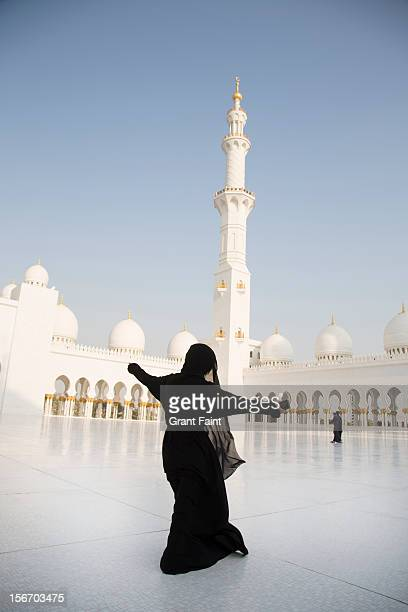 Muslim woman enjoying Sheik Zayed Mosque.