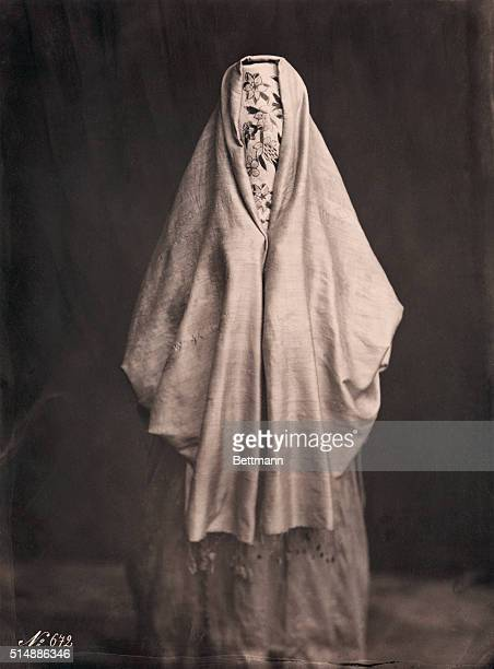 Muslim woman from North Africa wearing flowered face veil
