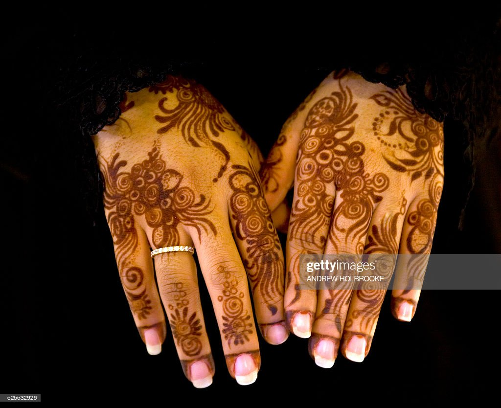 A Muslim woman from the Emirates shows her hands which are decorated with henna in floral designs Henna is used in the Islamic world by woman to...