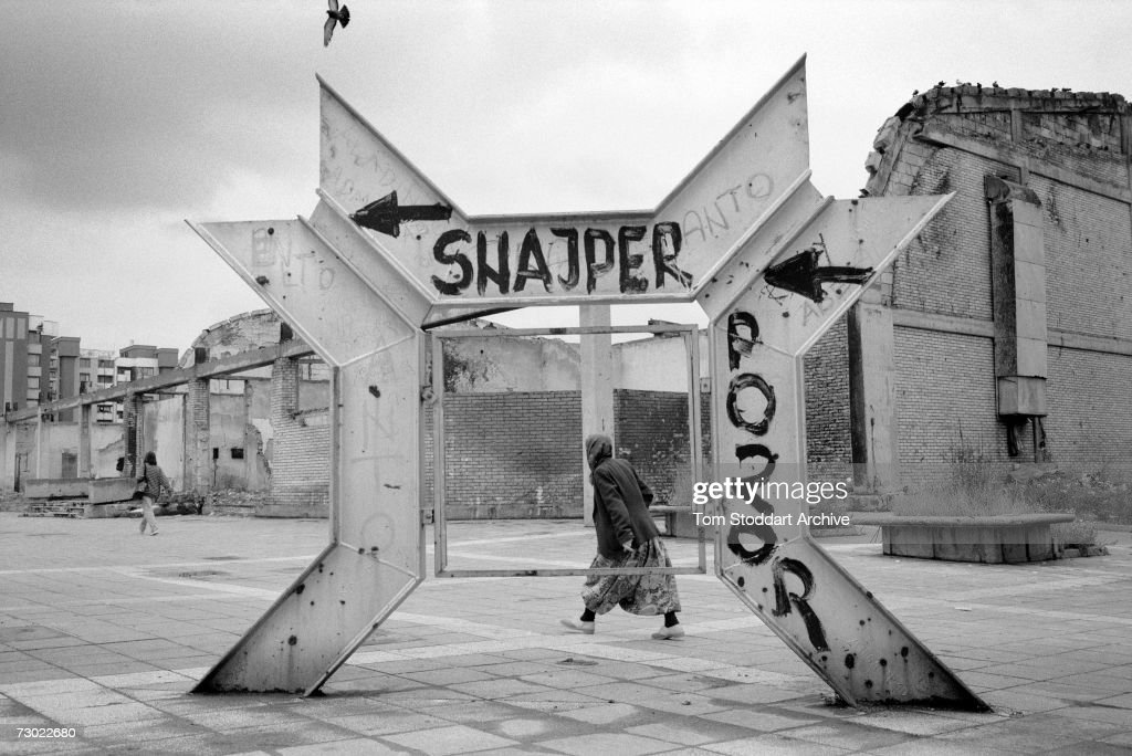 A muslim woman hurries past graffiti warning of snipers in a dangerous part of Sniper Alley. During the 47 months between the spring of 1992 and February 1996, the people of Sarajevo endured the longest siege Europe has witnessed since the end of the Second World War. More than 10,600 people were killed with a further 56,000 wounded or maimed.