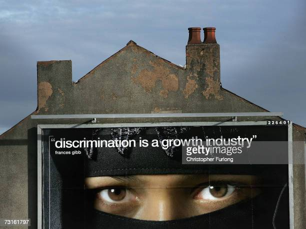 Muslim woman is pictured on an advertising billboard in the Bordesley Green area of Birmingham near to the location of a series of antiterror dawn...