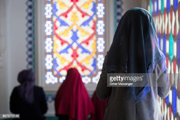 Muslim woman is seen during midday prayers at Sehitlik mosque which is mostly Turkish on Open Mosque Day on October 3 2017 in Berlin Germany Hundreds...