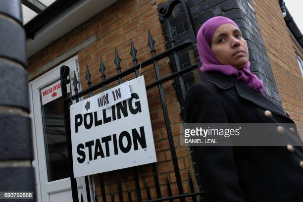 A Muslim woman leaves a polling station set up at the Muslim community centre in Ilford east London on June 8 as Britain holds a general election As...