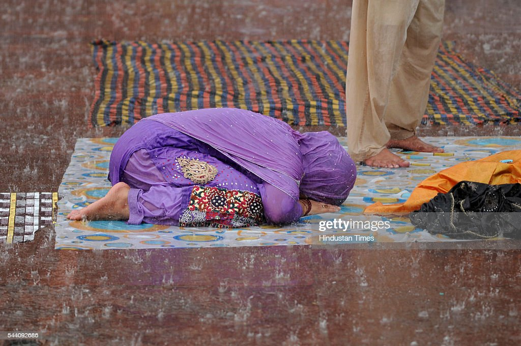 A Muslim woman offering her prayer as it rains heavily near Jama Masjid on July 1, 2016 in New Delhi, India. The capital received its first Monsoon rains dragging the maximum temperatures several notches below normal. Heavy downpour caused water logging and traffic jams in the city.