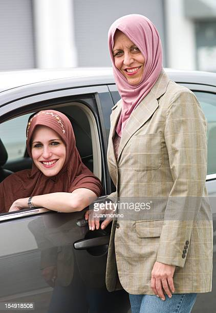Muslim woman poaing with her driving daughter