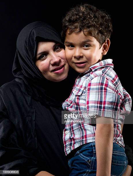Muslim woman posing with her son