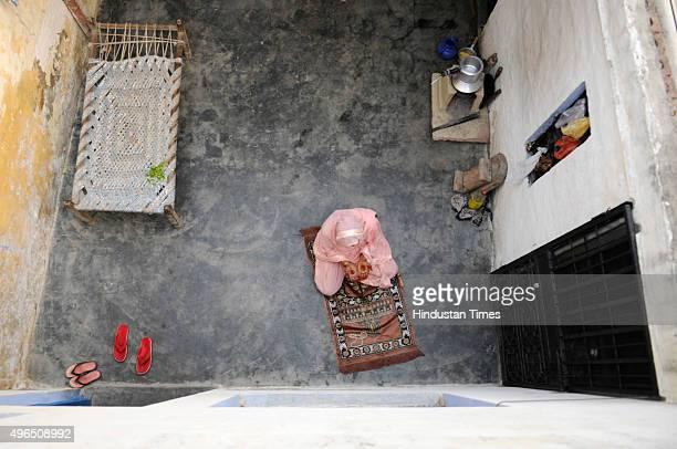 Muslim woman pray in her home at Bisada village on November 10 2015 in Dadri India Residents in Bisada village are not celebrating Diwali this year...