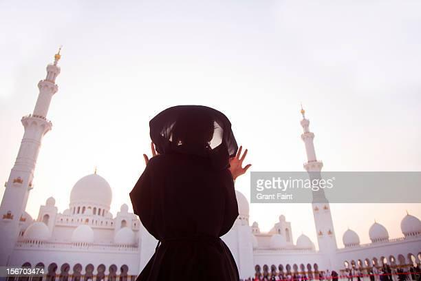 A muslim woman praying at Sheik Zayed mosque