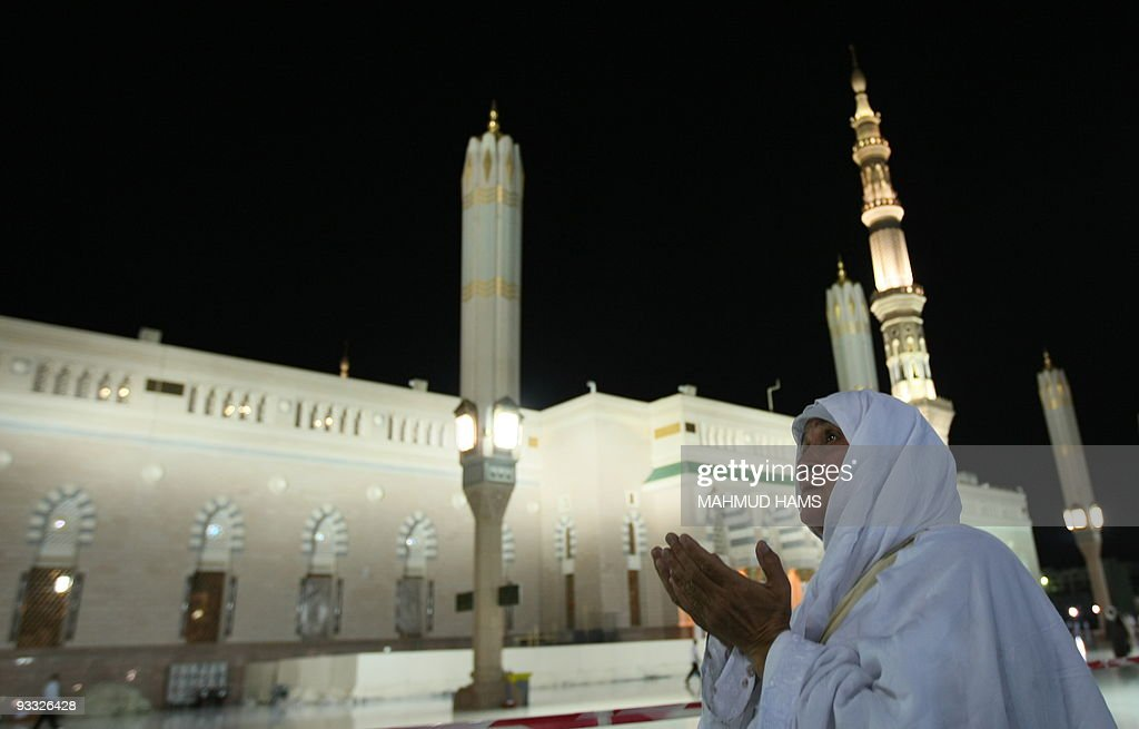 A Muslim woman prays in the courtyard of the Prophet Mohammed Mosque in the Saudi holy city of Medina on November 13 2009 More than three million...