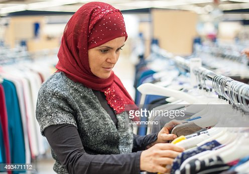 Muslim woman shopping for clothes