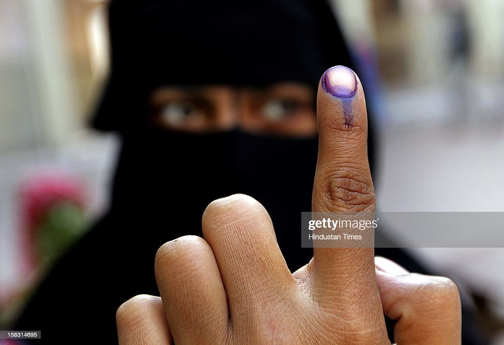 A muslim woman showing the polling mark on her finger during the first phase polling of Gujarat assembly election at Dholka on December 13, 2012 in Ahmedabad, India.