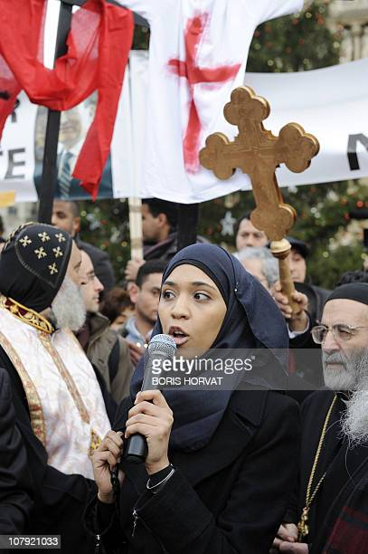 A Muslim woman speaks as she gathers on January 7 2011 in front of NotreDamedeParis cathedral in Paris to support Coptic people and protest against...