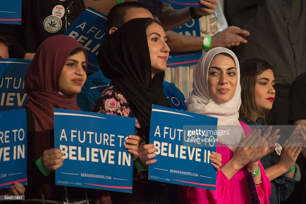 Muslim woman support Democratic presidential candidate Bernie Sanders during his campaign rally at the Riverside Municipal Auditorium on May 24, 2016 in Riverside, California. US presidential candidates have turned their attention to campaigning in earnest for the June 7th California primary election. / AFP / DAVID