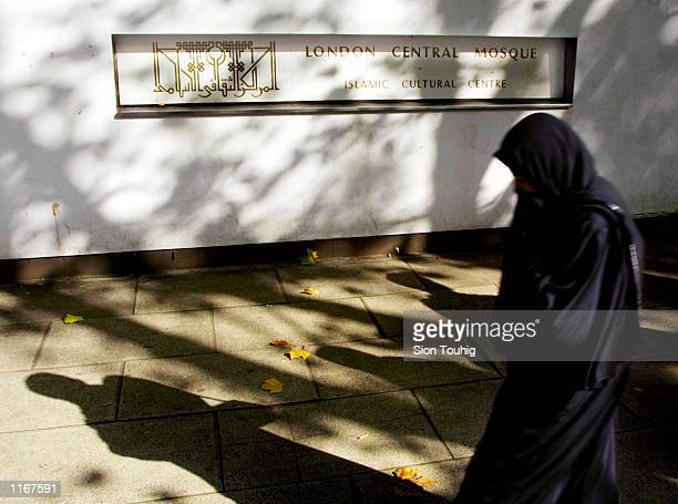 Muslim woman walks to the Central Mosque before Friday prayers October 12 2001 in London