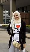 Muslim woman wearing a 'I Love New York' tshirt is seen in this 2009 Chicago Illinois early evening cityscape photo