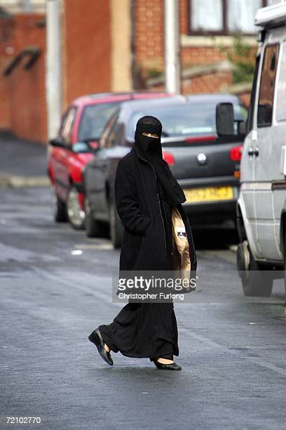 Muslim woman wearing a Niqab walks in the British northern town of Blackburn the constituency of MP Jack Straw where a quarter of his constituents...
